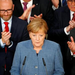 Merkel hangs on to power but bleeds support to surging far right