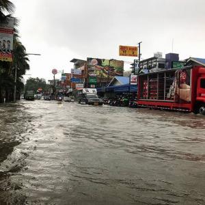 PHOTOS: Torrential rain leaves Pattaya Beach Road flooded