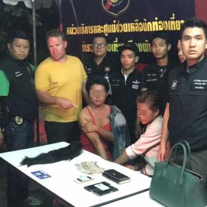 Two ladyboys arrested for robbing Australian tourist on Pattaya Beach Road