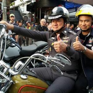 Governor joins Phuket Bike Week helmet giveaway awareness campaign