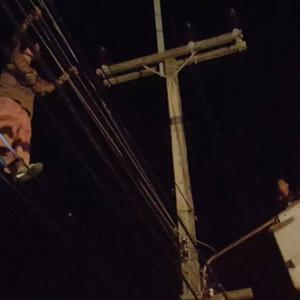 Man climbs utility pole, cries due to poverty woes