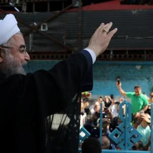 Decisively re-elected, Rouhani defies hardliners, pledges to open Iran
