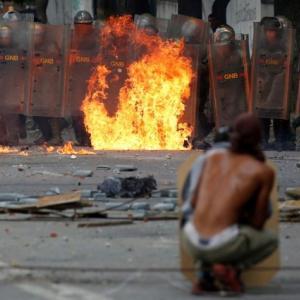 U.S. orders Venezuela embassy families out, crisis deepens