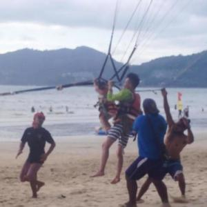Shocking moment terrified toddler, 2, screams as she is forced to go PARASAILING on Phuket beach