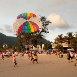 A Chinese tourist injured after fall from parasail ride on Patong Beach