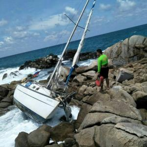 Couple safe, but missing, after boat dashed on rocks in Phuket storm